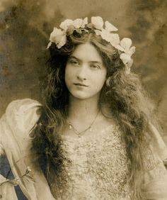 Beautiful girl with flower garland.  Note the festoon necklace.  No information.
