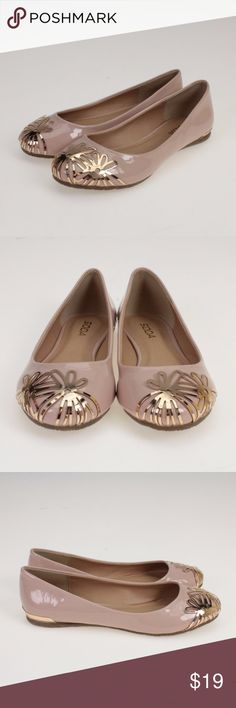 Blush Nude With Gold Metal Flowers Flats These adorable flats will go with just about anything! They are made of all man made materials with a faux patent leather exterior and rubber sole. These cute spring and summer shoes have floral accents on the front and a bit of trim in a gold looking metal. Soda Shoes Flats & Loafers