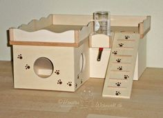 This wooden hideout toy for chinchillas and other small pets is amazing. They can climb, hide and even stop for a drink when they're thirsty.