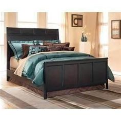 Queen Size Bedroom Set: headboard, footboard, rails, nightstand, dresser and mirror   Bought in June 2011 for $2100.00 at Ashley''s Furniture store in Headboard is a good height   Dark brown, almost black color Beautiful condition   ''Carlyle'' Edition    Must be able to pick up, it''s located in Gretna, La    Upgrading to a King Size, reason I am selling my current furniture  $1300.00READY TO SELL - MAKE AN OFFER!!  504-621-4133