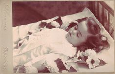 Postmortem portrait of a girl, ca. 1900.  Please, take photos of loved ones, often, whether they like it or not.