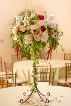 Candelabra featuring hydrangea, roses, dahlias, lisianthus, soft rounded blossoms,  feathery greens and ivy.