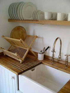 Floating shelf becomes drying rack over draining board... http://www.peterhendersonfurniture.co.uk/bespoke_kitchens.html