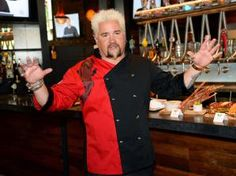 Chef and television personality Guy Fieri talks about his menu items during a welcome event for Guy Fieri's Vegas Kitchen & Bar at The Quad Resort & Casino on April 4, 2014 in Las Vegas, Nevada. - Ethan Miller/Getty Images Entertainment/Getty Images