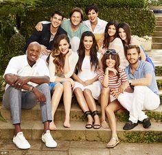 The gang's all here! Kim Kardashian poses with her family and it's extended members as official portraits for season eight of the clan's reality show Keeping Up With The Kardashians are released