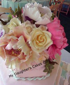 Beautiful sugar flowers!  Full peonies and roses in sugar, by My Daughter's Cakes (http://pinterest.com/njweddingcakes/sugar-flowers/)