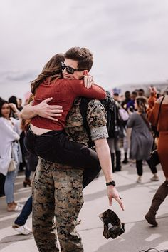 military homecoming Marine and Wife reuniting at their homecoming after a long deployment at Marine Core Air Station Miramar with VMFA 225 by Morning Owl Fine Art photography San Diego.