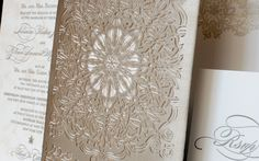 Lace inspired laser cut motif on a wedding invitation