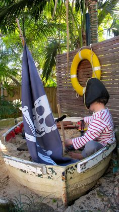 Two Little Pirates: The old boat sand pit or as it's being called on Pinterest, the sand box!