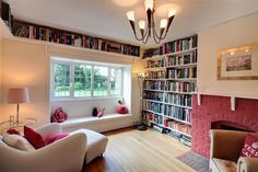 I love the above-the-window book shelving.