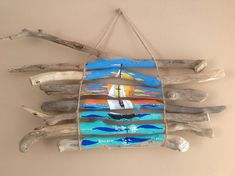 Another acrylic painting on driftwood sticks to replace a similar one ,recently sold.All my driftwood pieces have been found on the shores of Lake Ontario.They have been brushed clean with tap water and left in the summer sun for a couple weeks. Driftwood Wall Art, Painted Driftwood, Driftwood Projects, Seashell Painting, Painting On Wood, Pallet Painting, Stone Painting, Stick Wall Art, Painted Sticks