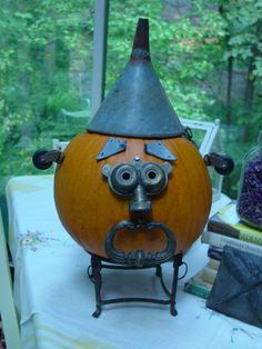 Junk-O-Lantern. Pumpkins decorated with funky old tools and other neat metal things my mom picked up.