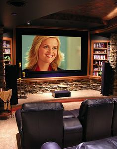 theater room-basement. Love the stone around the TV. I can imagine cupboards with stoned doors with easy access to the stereo and Xbox.
