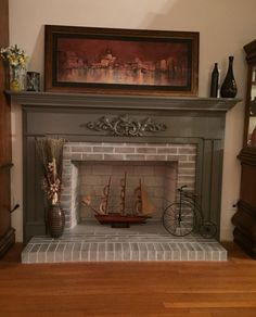My living room fireplace, I did a white wash on the brick and painted the mantel gray. Love...