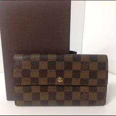 100%Authentic Louis Vuitton Vintage Sarah Wallet 100% Authentic Louis Vuitton Damier Ebene Vintage Sarah Wallet Old version. Pre-Owned wallet in good condition.  No smell, Corner area has some sign of usage. MADE IN SPAIN DATE CODE CA1918 ( November 1998 )   Please check all the pictures. -In order to avoid unnecessary return. - No return sold as is- Louis Vuitton Bags Wallets