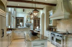 terrific layout and hood, great tilework in the cooking alcove, great lantern chandeliers - like those wire cabinet doors in the keeping room off the kitchen