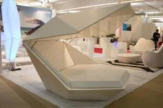 The large indoor-outdoor chair from the Monoo Collection has a roof that comes down to enclose the sitter inside a pod. It sells for from $8,000 to $13,000 and can be tricked out with lighting, battery power, and Bluetooth capabilities.