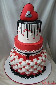 Red, white and black hearts cake ... So many great techniques here: the lace trim, the tufted quilting, the dripping streamers...!!
