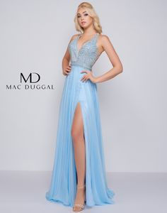 09bf5c09271 Feel everything but blue at prom in style The halter bodice cuts into a  V-neckline and has beautiful geometric embellishments. The light satin hem  flows ...