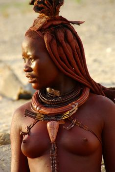 Ova Himba Woman | The Ova Himba people live in desert region of North West Namibia and are semi-nomadic herders. Although the do have regular contact with the Western world many Ova Himba prefer to continue their traditional lifestyle.