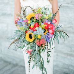 Flowers + feathers = one gorgeous bouquet! #theknot via @lauraivanova