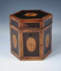 A George III fiddle back mahogany tea caddy, each of the hexagonal sides inlaid with satin wood patera within cross banding, the interior with single compartment lid, 13.5cm (5.25 in) high via invaluable.com