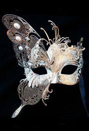 MASK295 is white and gold with a large laser cut butterfly wing.