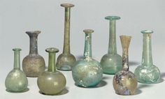 Ancient Roman Glass wine decanters from the 1st–4th Century AD auctioned by Christies.