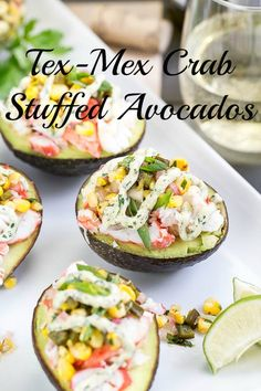 Tex-Mex King Crab Stuffed Avocados with Lime-Cilantro-Sriracha Crema. Perfect for your St. Patty's Day Celebration!