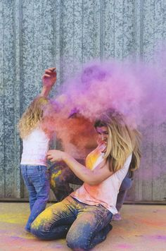 Fun colorful family photos using corn starch color bombs! Have a very bright Christmas indeed. Nothing says holiday cheer like the multi-colored smiles on their faces.