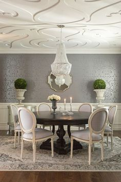 grey & ivory dining room, dark pedestal table, white Louis chairs with nailhead trim, oriental rug: