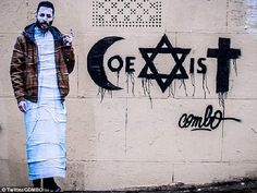 """Calling for peace: Graffiti artist """"Combo"""" attacked by gang in Paris ghetto for painting the word 'coexist' with Christian, Muslim and Jewish symbols in bid to inspire religious harmony"""