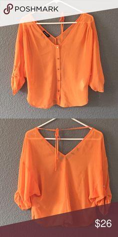 Bebe orange blouse Great condition. Adorable crop top ties in back bebe Tops Blouses