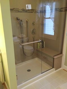 We Converted This Tub And Shower To A Shower With A Bench. It Features A  Corian Wall Surround With A Glass Tile Inset, Frame Less Heavy Glass Hinged  Door ...