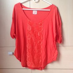Free People Shirt 100% cotton in the body. Lace going down the front only. Low-cut. Coral. Tag is off--but never worn Free People Tops Blouses