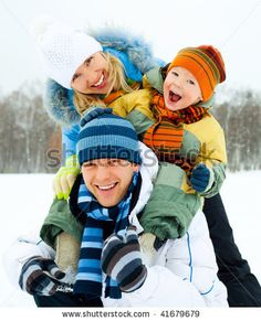 Happy Family, Young Couple And Their Son Spending Time Outdoor In Winter Stock Photo 41679679 : Shutterstock