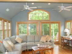 A sunroom with high ceilings and big windows.