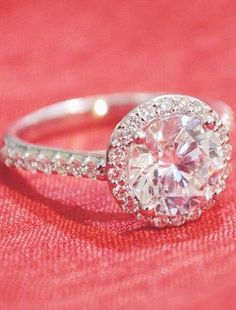 Halo Diamond Ring---If that main stone was a colored diamond...OMG!