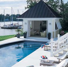 Classic pool and pool house. Pinned to Pool Design by Darin Bradbury.