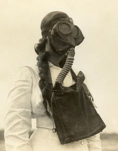 WWI nurse wearing a gas mask