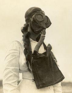 WWI nurse wearing a gas mask