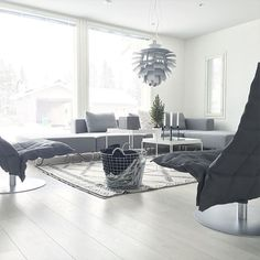 Woodnotes Swivel k Chairs, narrow, upholstered with Sand paper yarn cotton fabric. Living room. Nordic home.