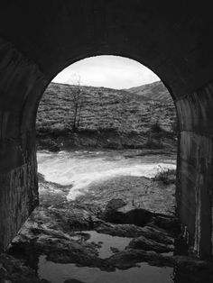 View through the old bridge out onto the mountains. Lochailort, Scotland
