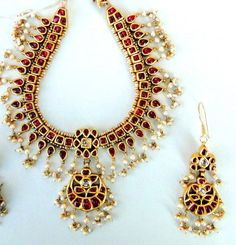 Necklace set. I found this store on Facebook called Kundan Hut. You won't believe it but this silver with gold plating and cabochon cut red onyx!!!