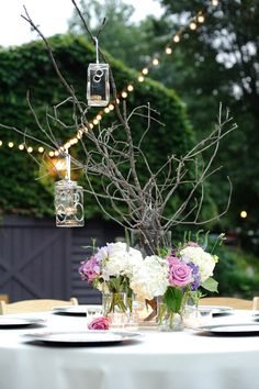 Stunning outdoor lighting, pink and white flowers, and table settings at Hawkedene House - Smoky Mountain Destination Wedding Venue