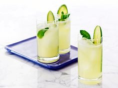 CUCUMBER COCKTAIL.  1 cup cucumber vodka-1 cup tonic water-1/2 cup cucumber juice-1/4 cup fresh lime juice-1/4 cup simple syrup (equal amounts sugar and water heated until sugar dissolves; cool)-Handful fresh mint leaves-Ice cubes, for serving