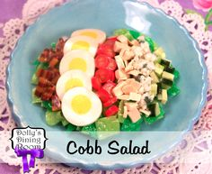 This main dish salad is sure to become a summertime favorite! A bed of fresh Romaine lettuce is beautifully topped with grilled chicken, bacon, hard-boiled eggs, chopped cucumber, halved cherry tomatoes, and crumbled Roquefort cheese.