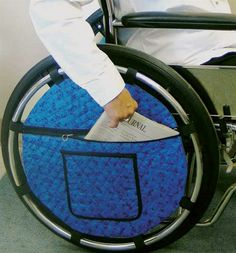 Quilted Wheel Pouch for Wheelchair - attaches with velcro. Large pouch for reading materials and inner pouches for valuables. For sale at this site.