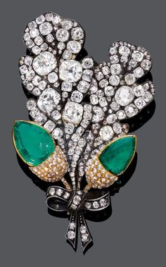 EMERALD AND DIAMOND BROOCH, Russian, 19th century. Designed as two oak leaves with acorns, the acorns set with two fine, drop-cut Columbian emeralds and set throughout with old European- and rose-cut diamonds, mounted in silver and gold. Provenance: Grand Duchess Maria Pavlovna of Russia (1786-1859) was the first owner of this brooch. - Don't be tricked when buying fine jewelry! Follow the vital rules at http://jewelrytipsnow.com/a-simple-guide-to-purchasing-fine-jewelry/