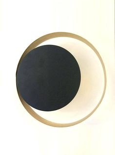 CYCLOPS Wall lamp with brass and black metal finish  diameter 26cm wall projection: 8cm wall canopy 7cm max 60w g9 bulb   *Notice that the pendant comes without bulbs but fits all voltages 110-220V  Bulbs not included The product is wrapped and packed carefully especially for long